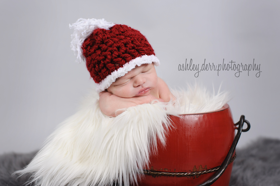 newborn baby boy in christmas hat