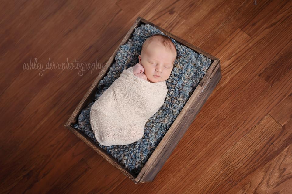 cute newborn boy pose