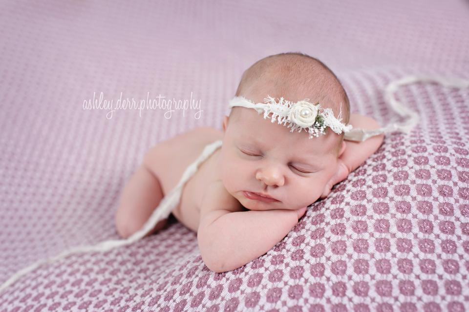 newborn head on arms