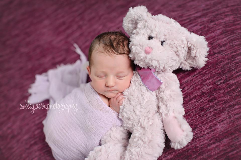 smiling newborn baby girl